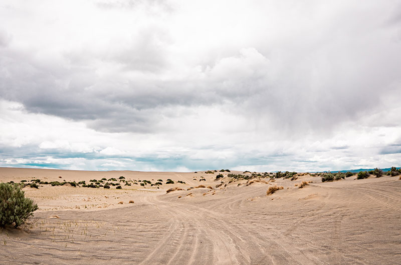 Landscape photo of the Sand Dunes with a cloudy sky