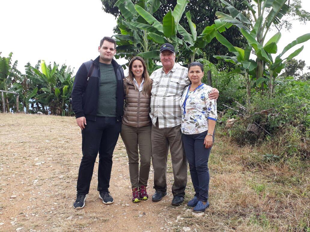 Maria Del Rosario and José Ramon, with Will and coffee buyer Maria Olano