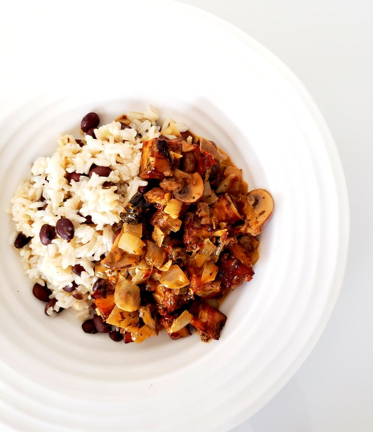 Bowl of Jerk Tofu and Mushrooms over Black Bean Rice