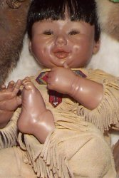 closeup Native American papoose doll