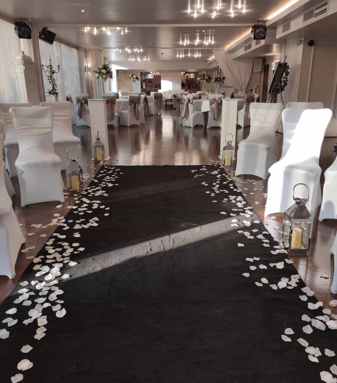 Wedding ceremony with black aisle runner