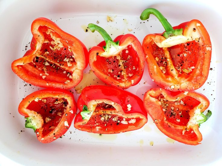 Red pepper sliced in half and drizzled with olive oil