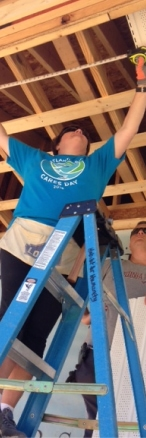 Atlantic Bay employee volunteers on RocSolid playset build