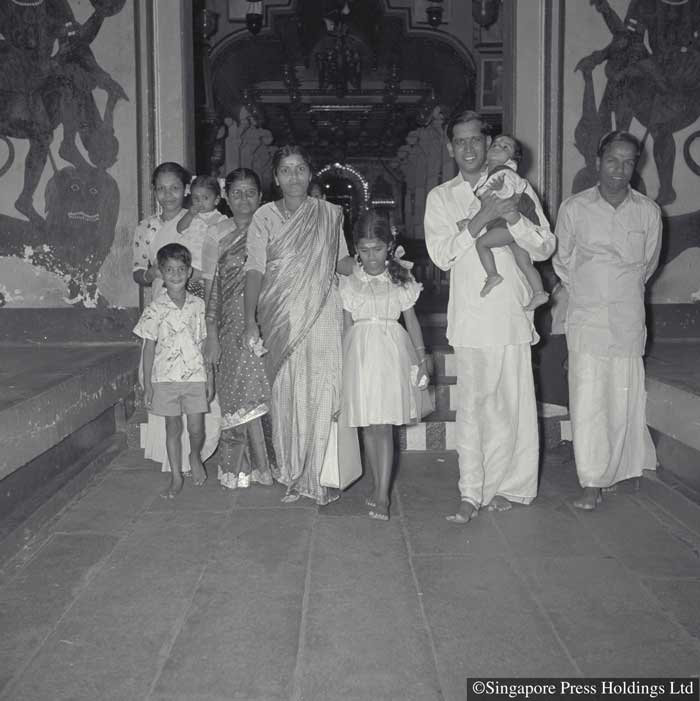 Hindu family at a temple for prayers during Deepavali, 1956