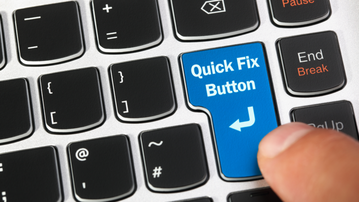 """Person pressing """"Quick Fix Button"""" on computer keyboard"""