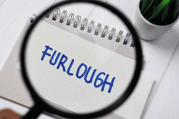 A spyglass with the word Furlough in focus