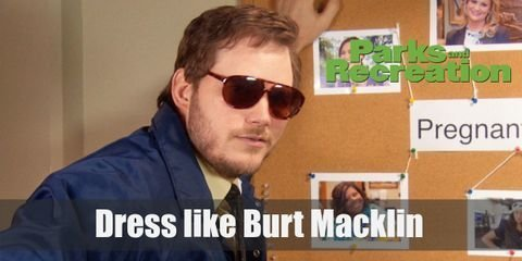 Andy uses his Burt Macklin alter ego when the need for law enforcement arises. Burt Macklin looks like a super cool FBI Agent. He wears a light yellow shirt with a brown necktie around his neck, a blue FBI jacket, and awesome-sauce brown sunglasses.
