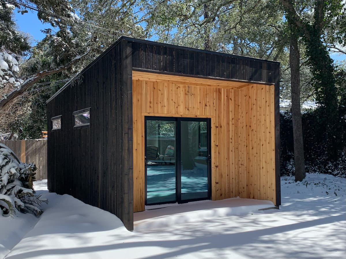 Backyard office shed exterior in snow