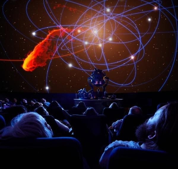 Audience of the planetarium watching a screening