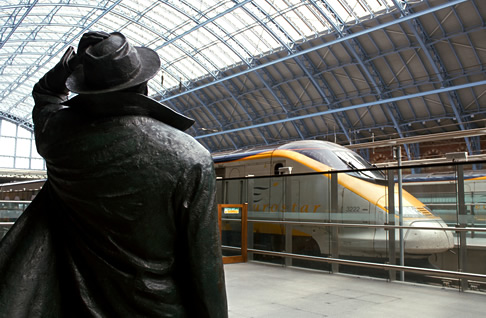 Sir John Betjeman looks towards the Eurostar at St. Pancras Station