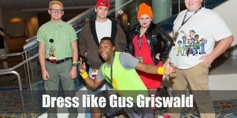 Gus Griswald's school outfit is reminiscent of a military uniform consisting of mostly greens and browns.