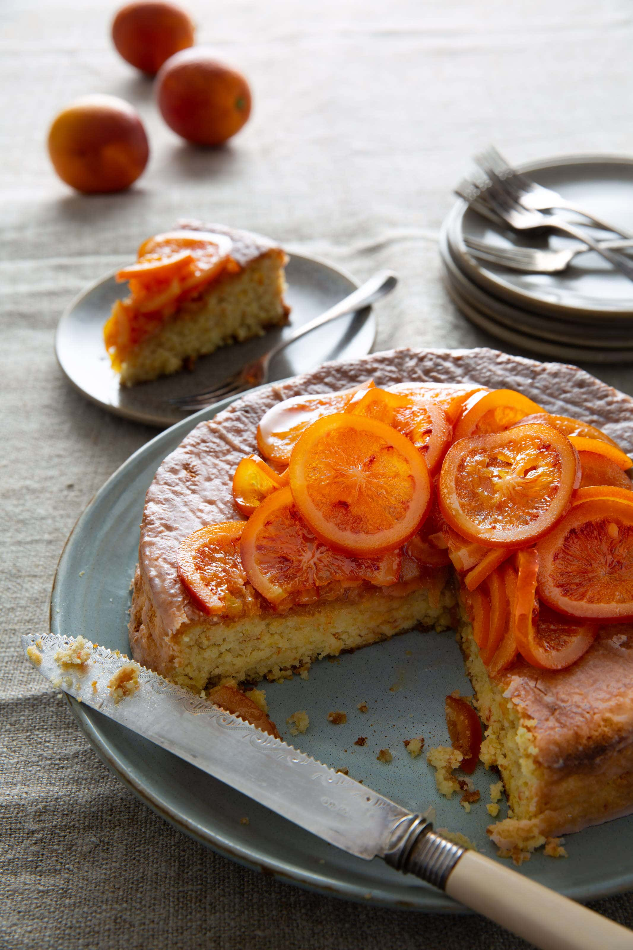 almond and blood orange cake with candies blood oranges on top.