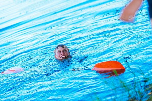 A person swimming in the dam.