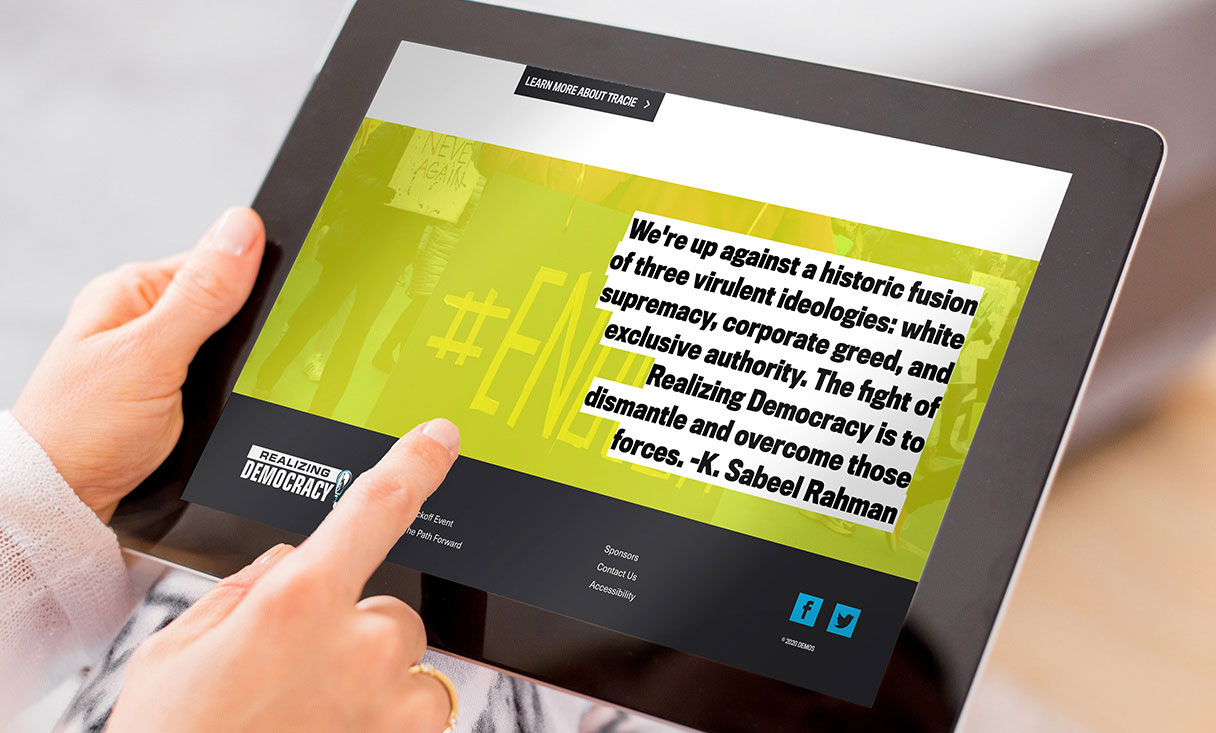 realizing democracy footer page with quote viewed on a tablet.