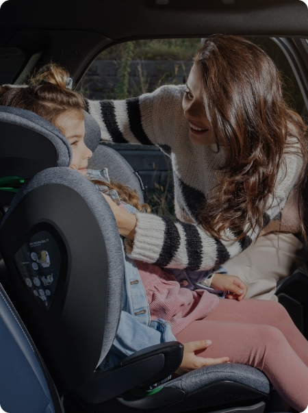 A girl in an Avionaut car seat