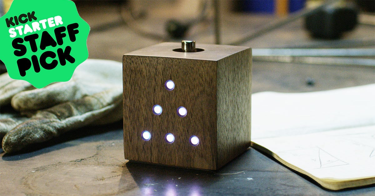 Clock on table with Kickstarter logo