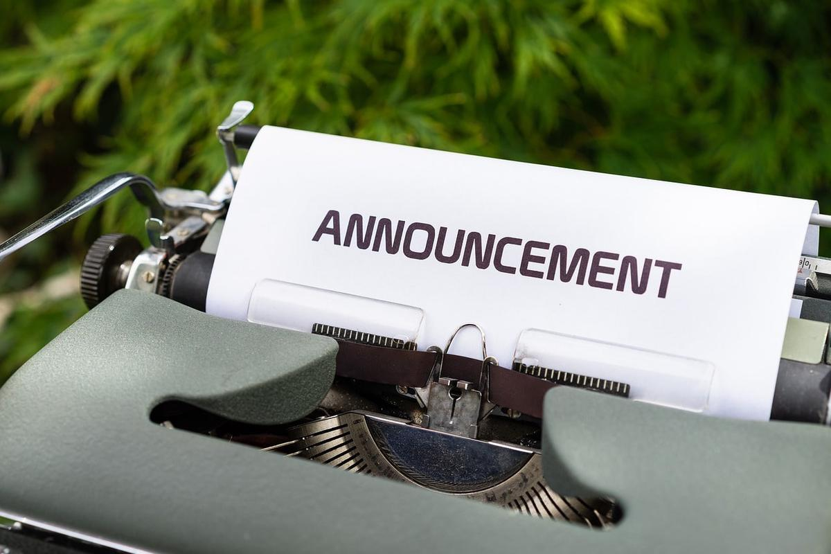 Paper with heading 'Announcement' fixed in an old mechanical typewriter.