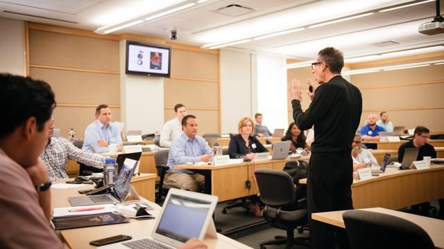 Photograph of SMU Cox faculty teaching a class