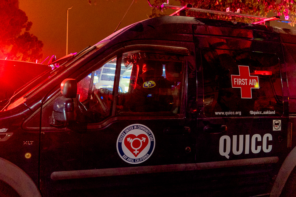 An Oakland police officer drives the Queers United in Community Care first aid van away to be impounded after some members were detained and one arrested during the 'Justice for Jacob' protest in Oakland, Calif., August 26, 2020. QUICC is a 'queer-led mutual aid and street medic collective', according to their website.