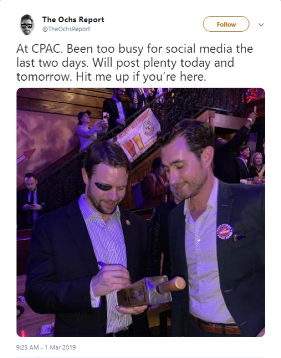 Nick Ochs posing at CPAC with Texas Representative Dan Crenshaw.