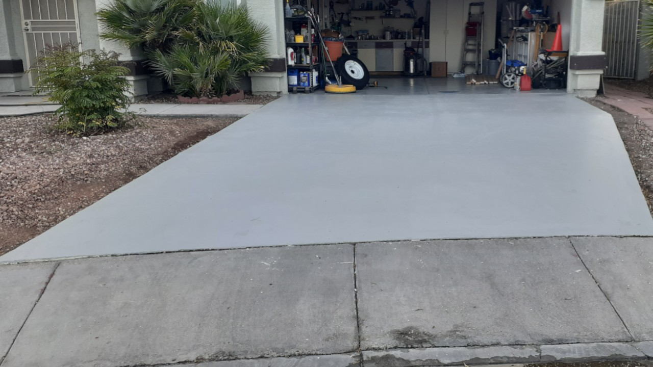 Concrete driveway restoration from heat and water damage