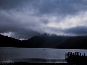 Lake with mountains behind at an unknown shinkansen way stop in Japan