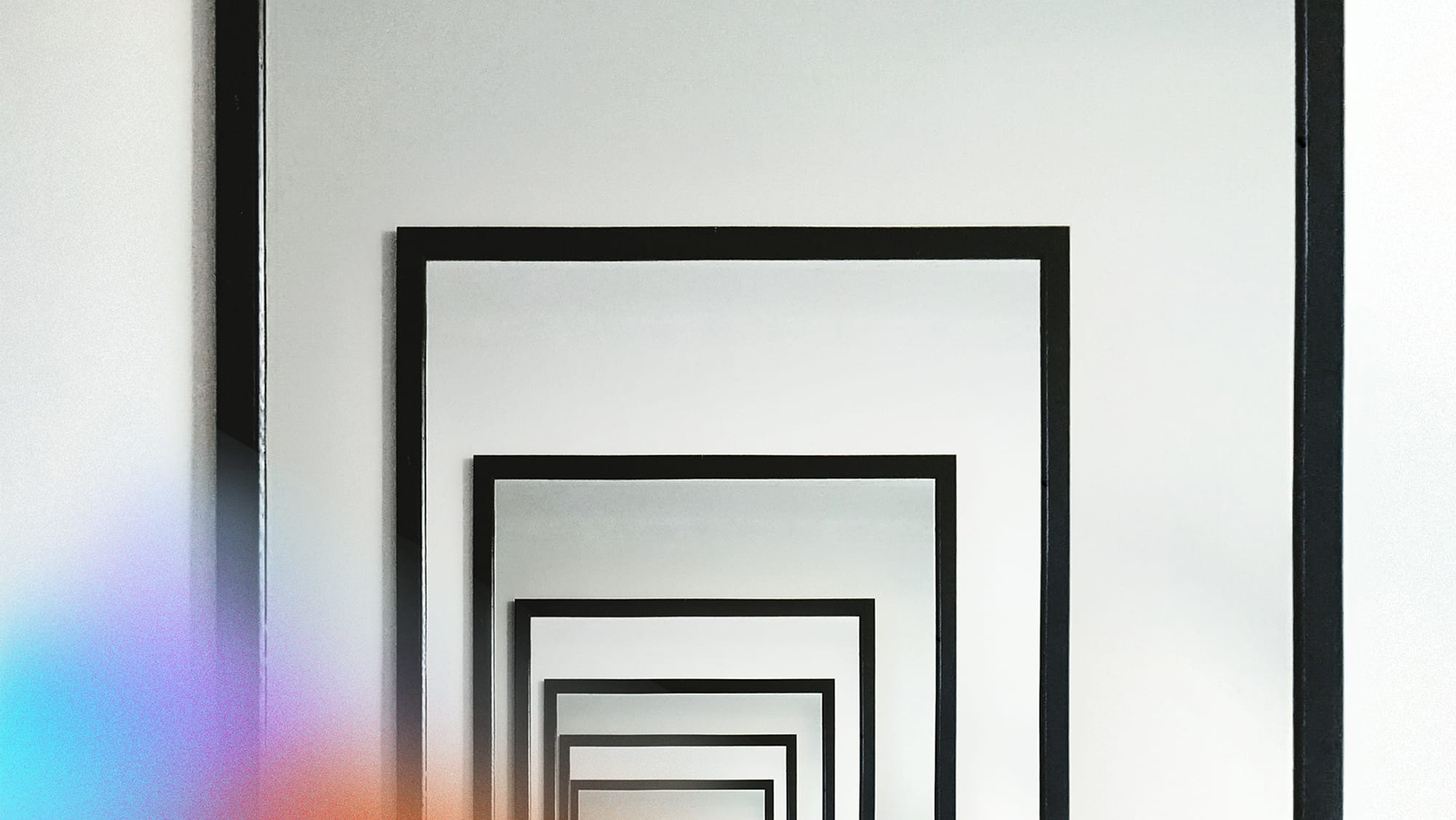 A series of mirrors reflecting each other ad infinitum.