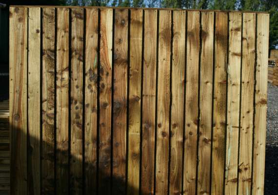 Wooden post and panel fence