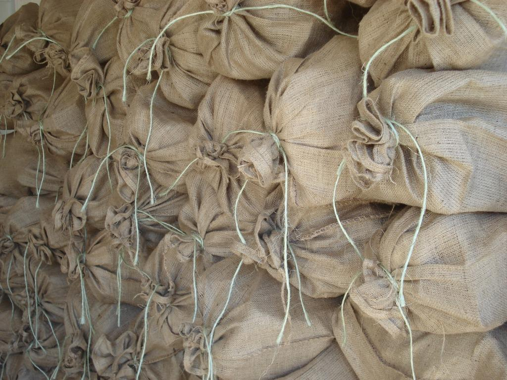 Hessian sacks of dry firewood. Recycling 0.50c per sack