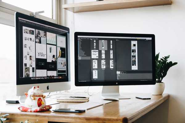 Picture an iMac with a second monitor and a design prototype on the screens.