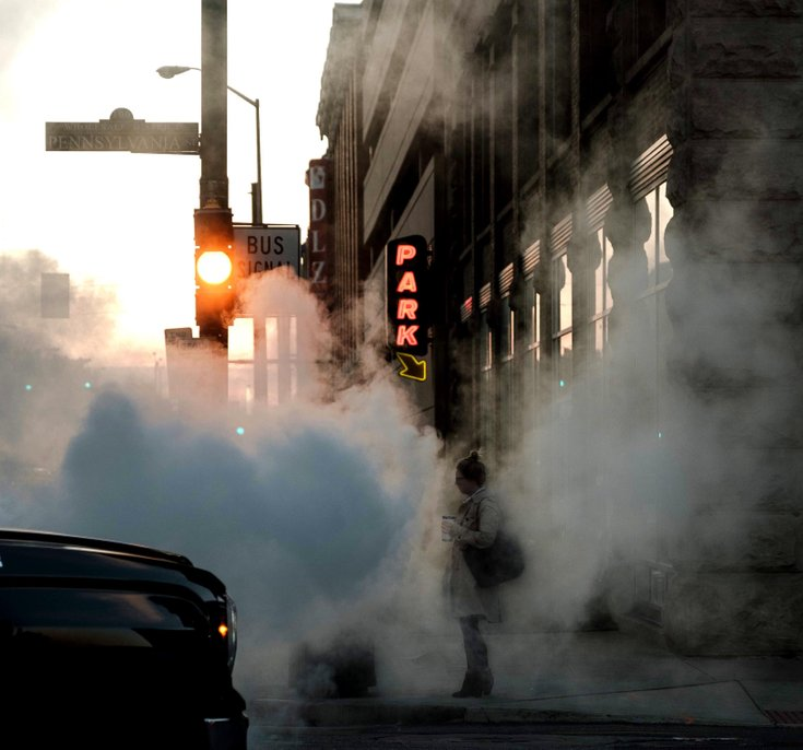 Someone standing on street with air pollution