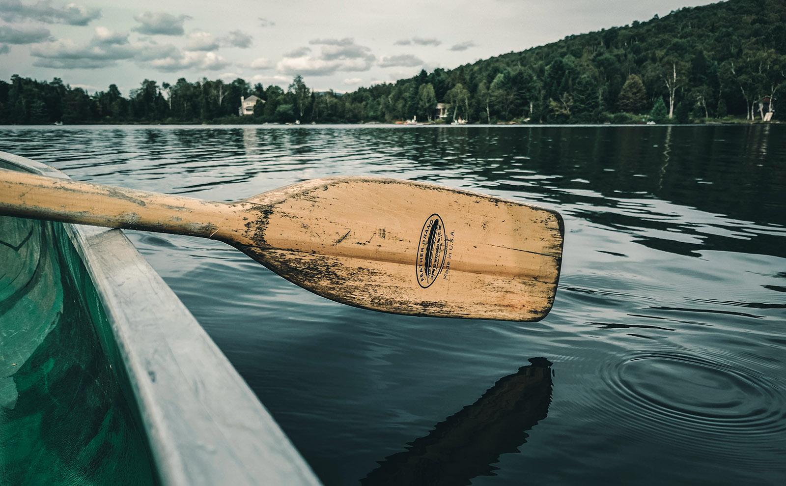 a canoe on a glassy lake