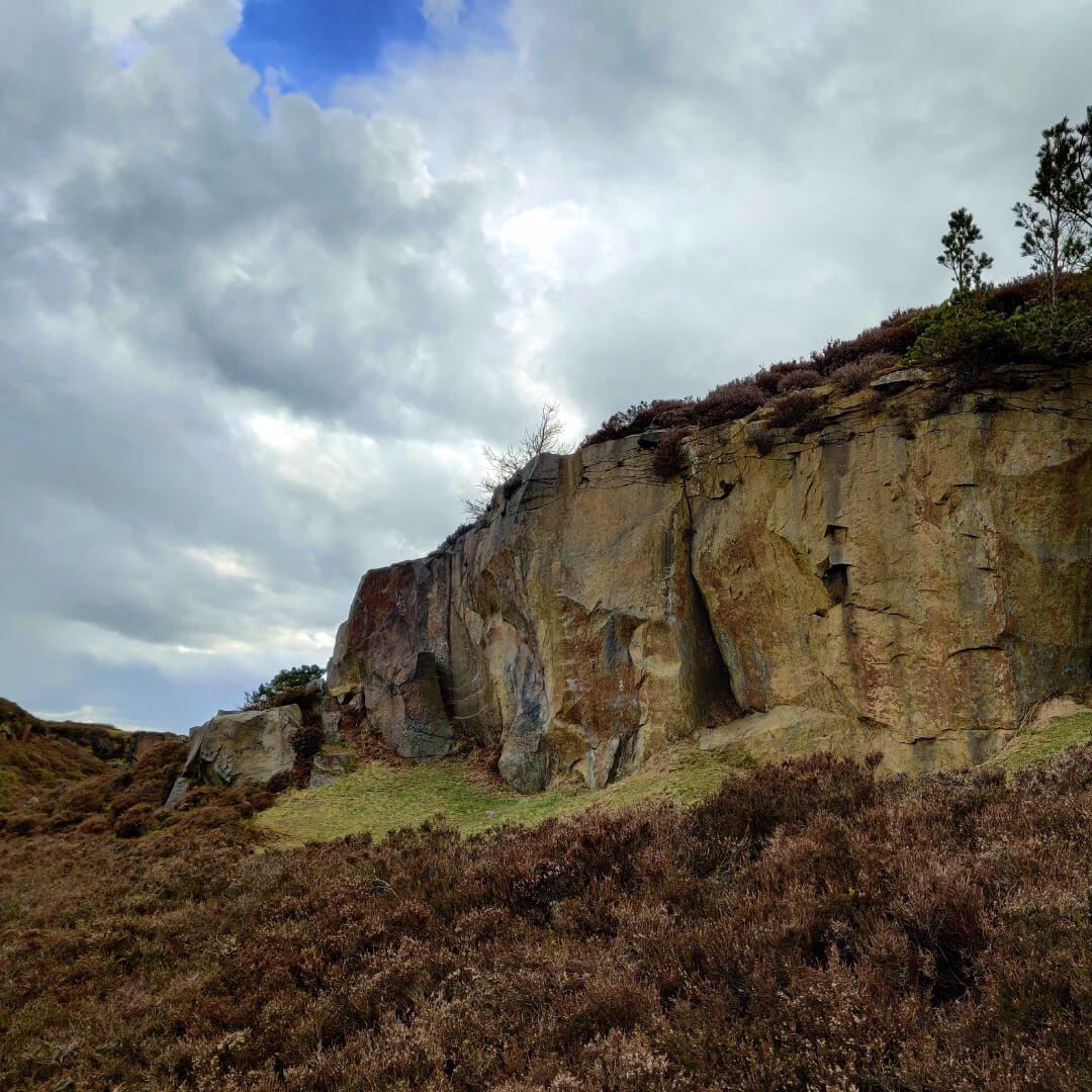 Ilkley Moor cliff and dark sky