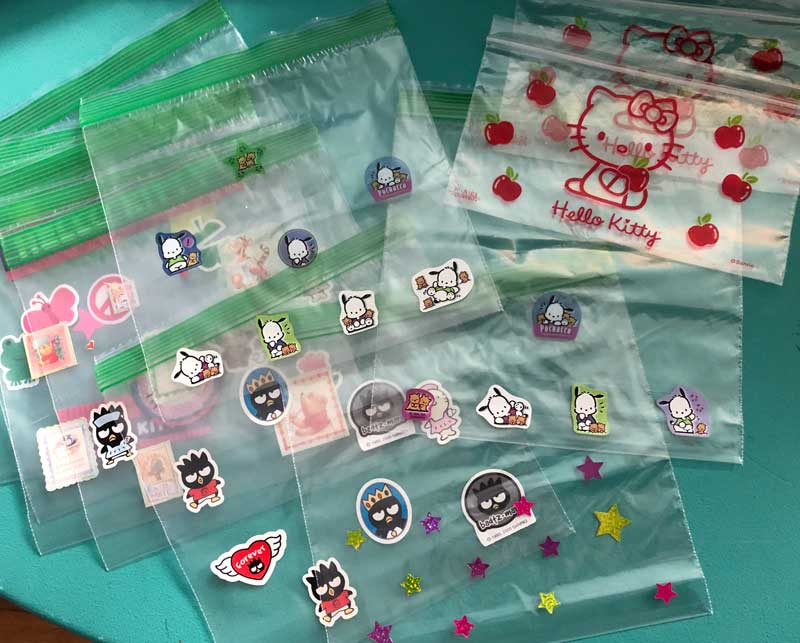 decorating the ziplock baggies with stickers
