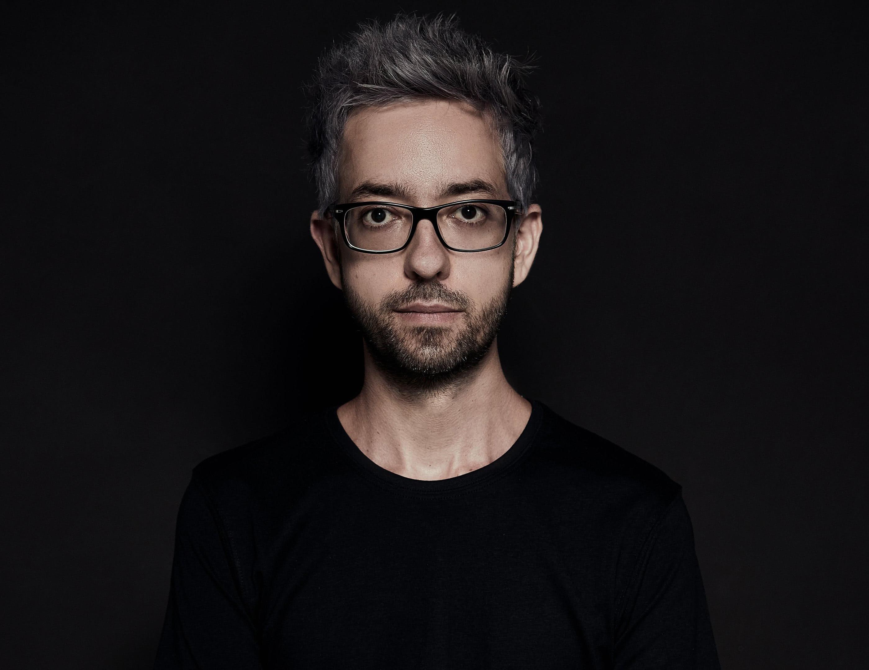 Photography of Ignacio in a dark background