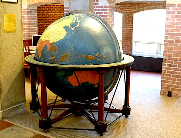 The enormous globe in the main hall, tall as the average adult body, painted brightly and covered with tactile mountain ridges and other land forms.