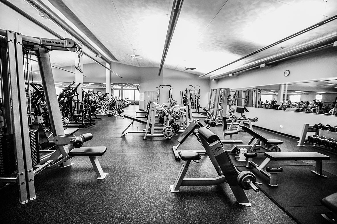 Lots of free weights and cardio/conditioning equipment on the gym floor.