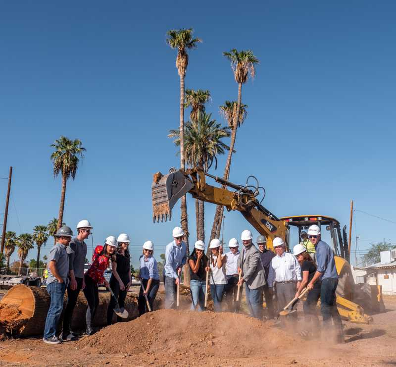 Construction excavator breaking ground for Tempe site