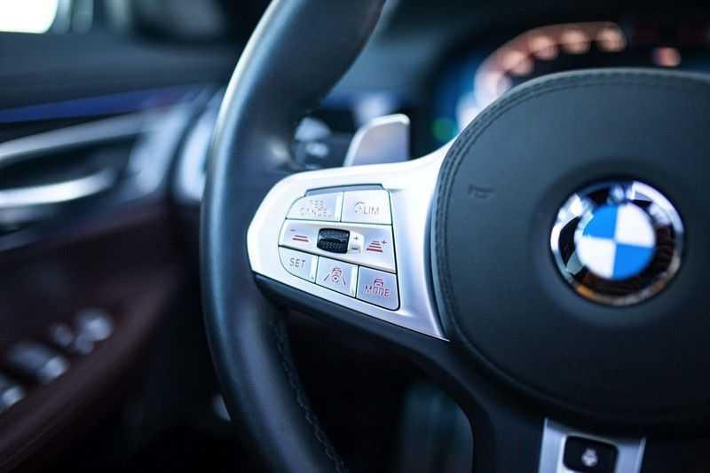 BMW 7 Serie 740d xDrive *Schuifdak / H&K / Memory / LED / ACC / Stoelventilatie* afbeelding 4