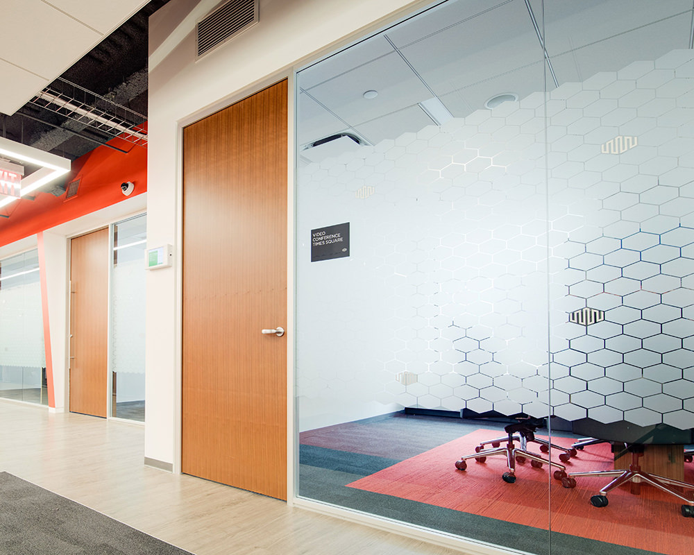 Hallway with Wooden Doors and Glass Walls