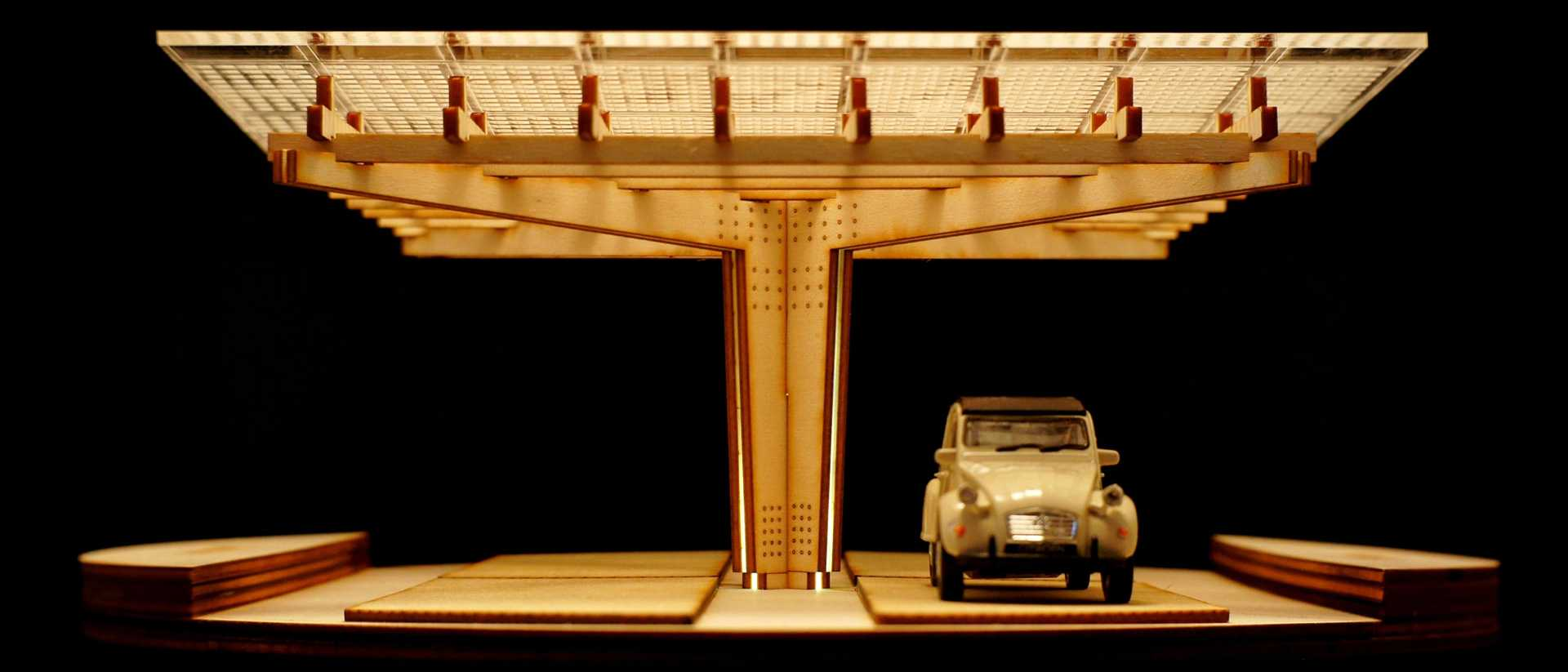 A miniature scaled development model of K:Port with a toy car.