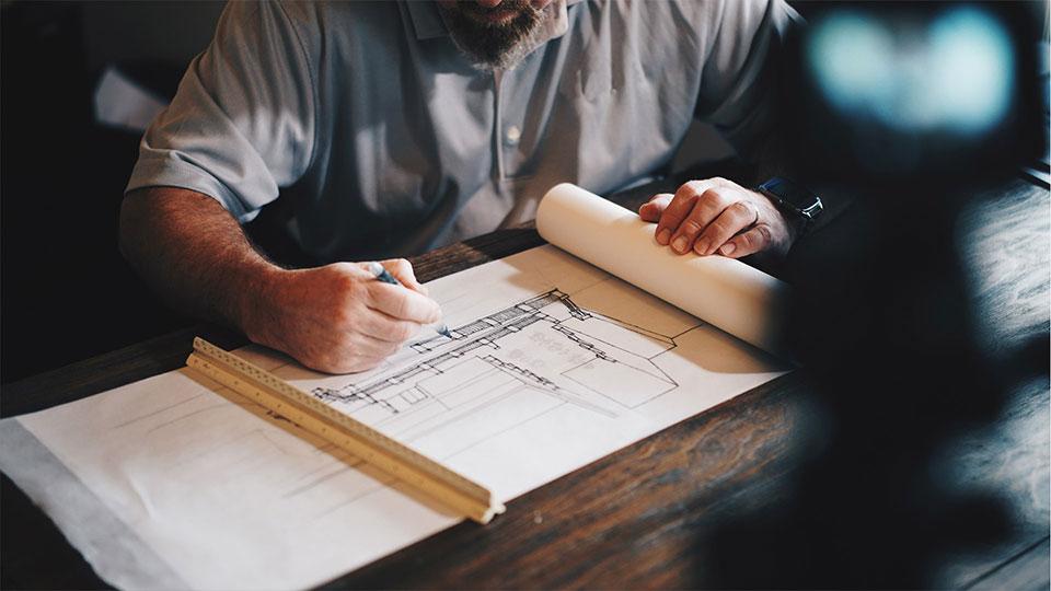 Man studying blueprints