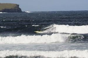 Peter speeding down a wave