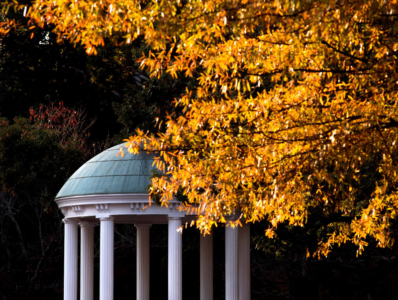 Close-up view of the Old Well with fall leaves turning above