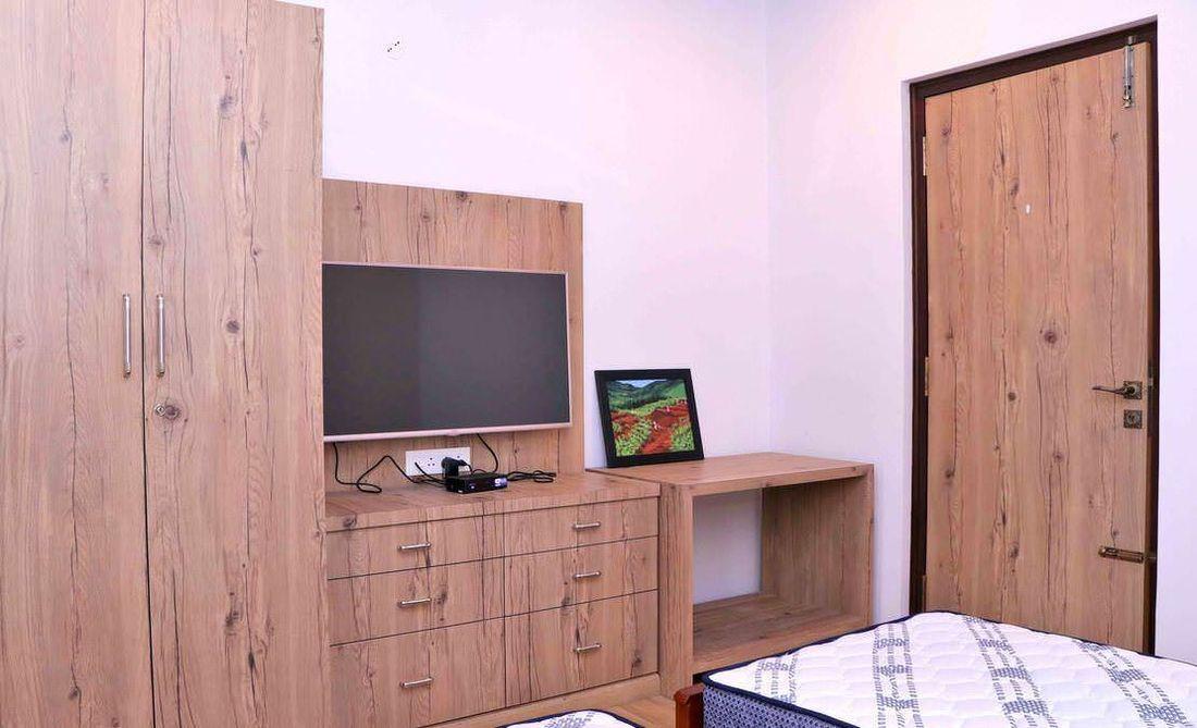Guest bedroom wardrobe and TV unit at Streamside Marigold