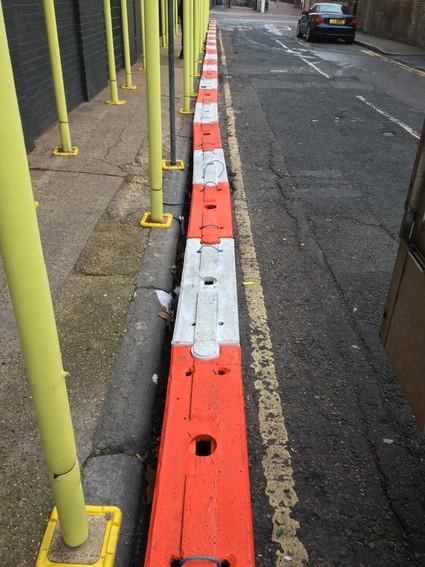 Self weighted traffic log near scaffolding
