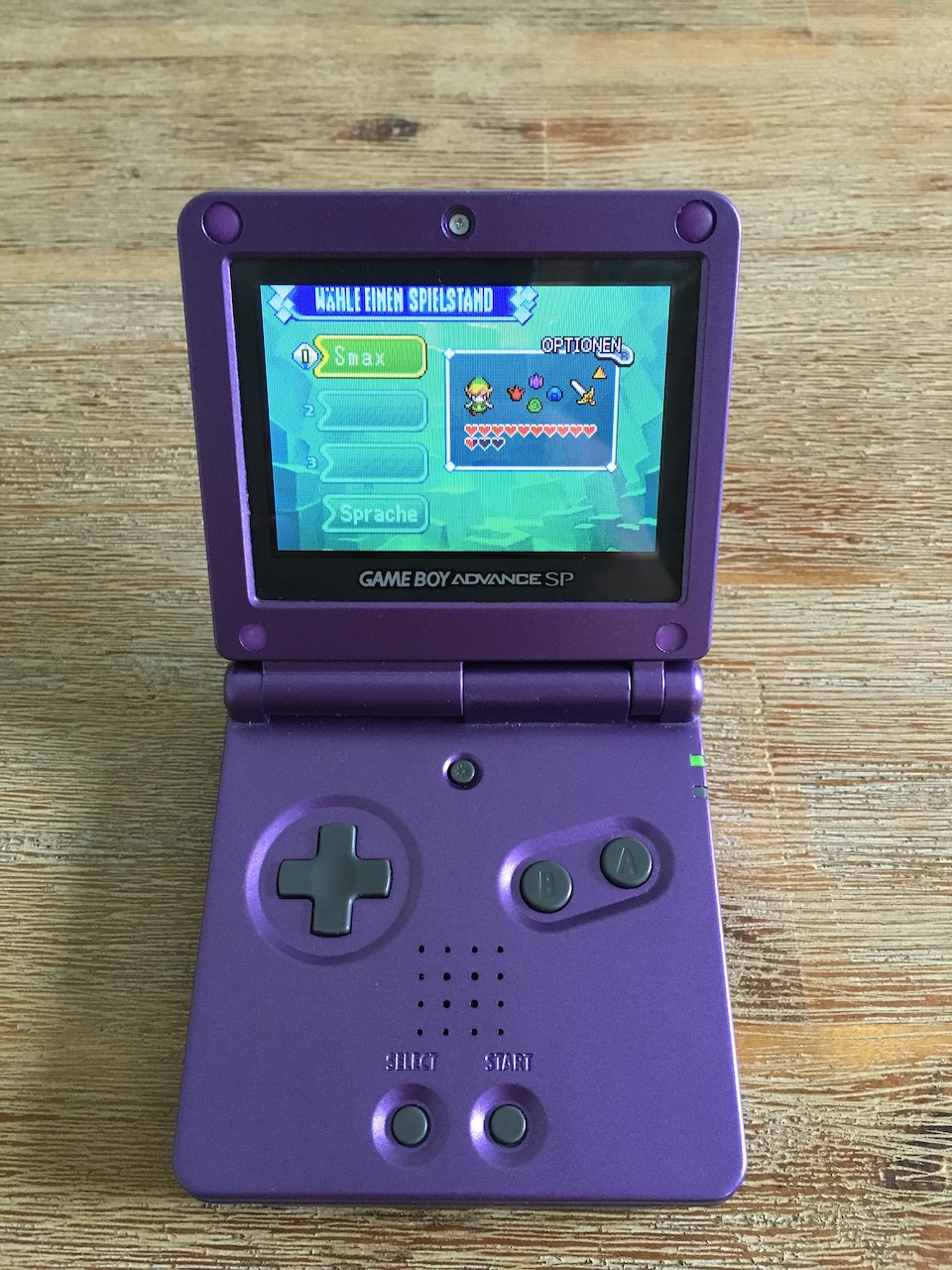 A Game Boy Advance SP showing the save game screen from The Legend of Zelda: The Minish Cap