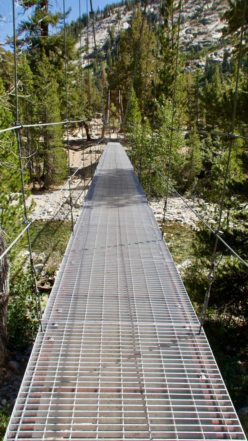 The suspension bridge over Woods Creek