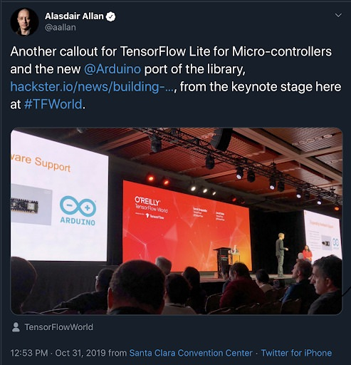 Alasdair Allan on Twitter, photo of Man and woman on stage in front of conference crowd, with Arduino and O'Reilly TensorFlow slides on rear screens.