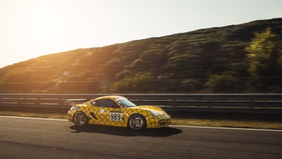 Porsche Cayman GT at the circuit of Zandvoort, the Netherlands  by Marc Kleen via Unsplash
